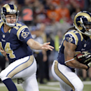 St. Louis Rams quarterback Shaun Hill, left, hands off to running back Tre Mason during the first quarter of an NFL football game against the Denver Broncos, Sunday, Nov. 16, 2014, in St. Louis The Associated Press