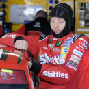 Kyle Busch climbs into his car before practice for Sunday's NASCAR Coca-Cola 600 Sprint Cup series auto race at Charlotte Motor Speedway in Concord, N.C., Thursday, May 21, 2015. (AP Photo/Mike McCarn)