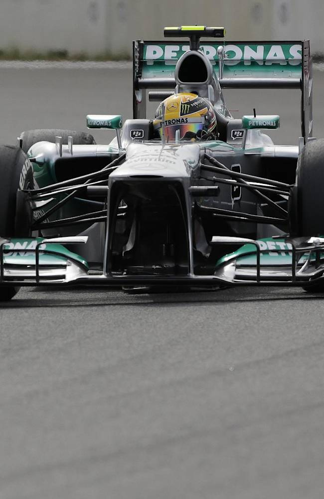 Mercedes driver Lewis Hamilton of Britain steers his car during qualifying at the Korean Formula One Grand Prix at the Korean International Circuit in Yeongam, South Korea, Saturday, Oct. 5, 2013
