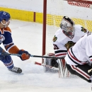Chicago Blackhawks goalie Antti Raanta (31) is scored on by Edmonton Oilers' Nail Yakupov (10) as Brent Seabrook (7) looks back during the third period of an NHL hockey game Friday, Jan. 9, 2015, in Edmonton, Alberta The Associated Press