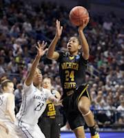 Wichita State's Alex Harden (24) shoots past Penn State's Ariel Edwards (23 )during the first half in a first-round game in the NCAA college basketball tournament on Sunday, March 23, 2014, in State College, Pa. (AP Photo/Keith Srakocic)
