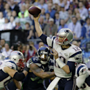 New England Patriots quarterback Tom Brady (12) throws a pass during the first half of NFL Super Bowl XLIX football game against the Seattle Seahawks Sunday, Feb. 1, 2015, in Glendale, Ariz. (AP Photo/David J. Phillip)