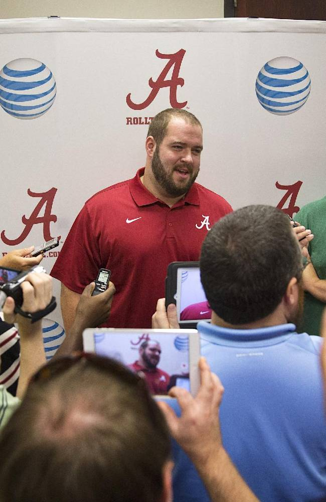 Alabama offensive linesman Austin Shepherd (79), center, speaks to the media during an NCAA college football press conference on Monday, Aug. 25, 2014, in Tuscaloosa, Ala