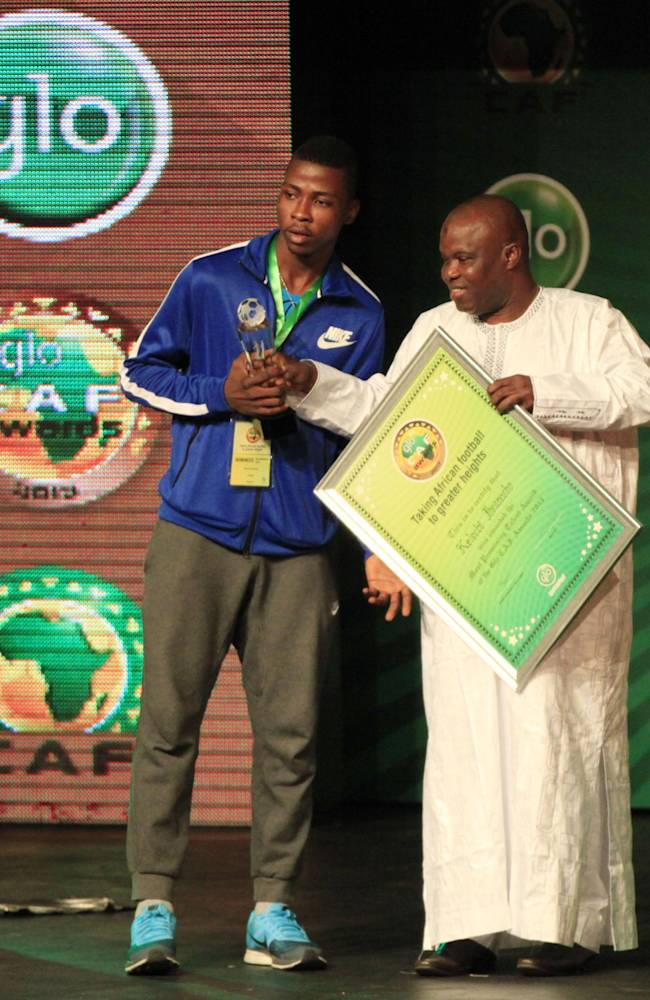 Nigeria's Kelechi Iheanacho, left, receives an awards of the Most Promising Young African Soccer Talent at the Glo Caf Awards, in Lagos, Nigeria, Thursday, Jan. 9, 2014