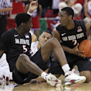 San Diego State's Xavier Thames grabs a loose ball from Fresno State's Cezar Guerrero as Dwayne Polee II watches during the first half of an NCAA college basketball game in Fresno, Calif., Saturday, March 1, 2014 The Associated Press
