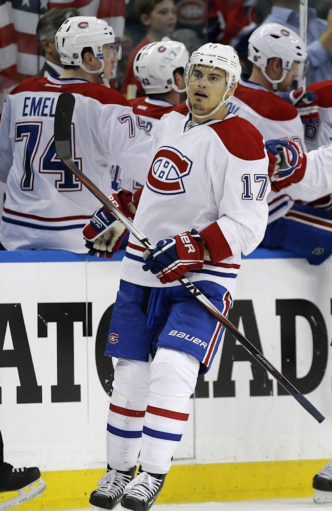 Montreal Canadiens left wing Rene Bourque (17) celebrates with teammates after scoring against the Tampa Bay Lightning during the second period of Game 2 of a first-round NHL hockey playoff series on Friday, April 18, 2014, in Tampa, Fla