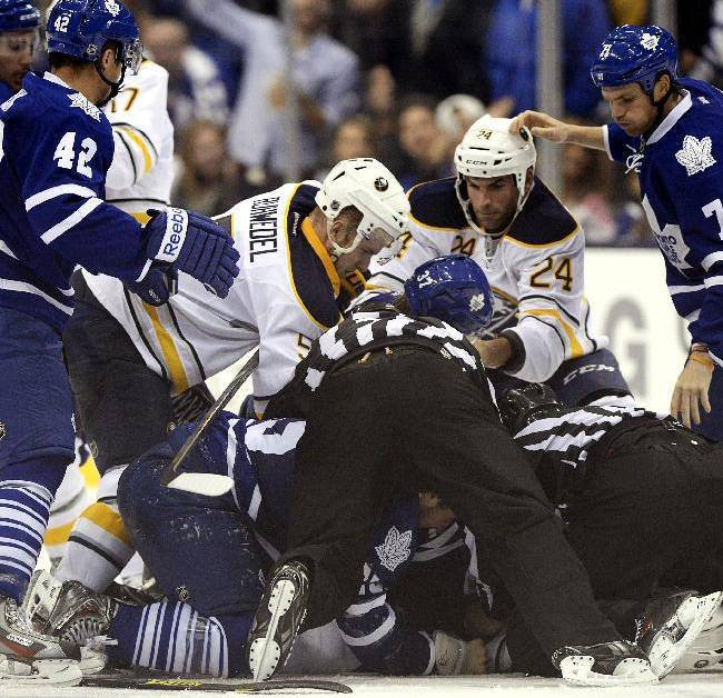 Buffalo Sabres and Toronto Maple Leafs pile-up during the third period of an NHL hockey preseason hockey game in Toronto, Sunday, Sept. 22, 2013