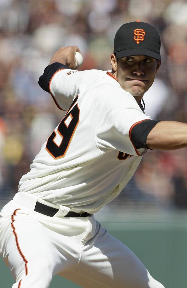 In this April 4, 2012, file photo, San Francisco Giants relief pitcher Javier Lopez works during an exhibition baseball game against the Oakland Athletics in San Francisco. Lopez finalized his $13 million, three-year contract on Tuesday, Nov. 26, 2013, to stay with the Giants  Lopez agreed to terms on the new deal last Thursday, but needed to travel to the Bay Area to undergo his physical Tuesday before signing the contract