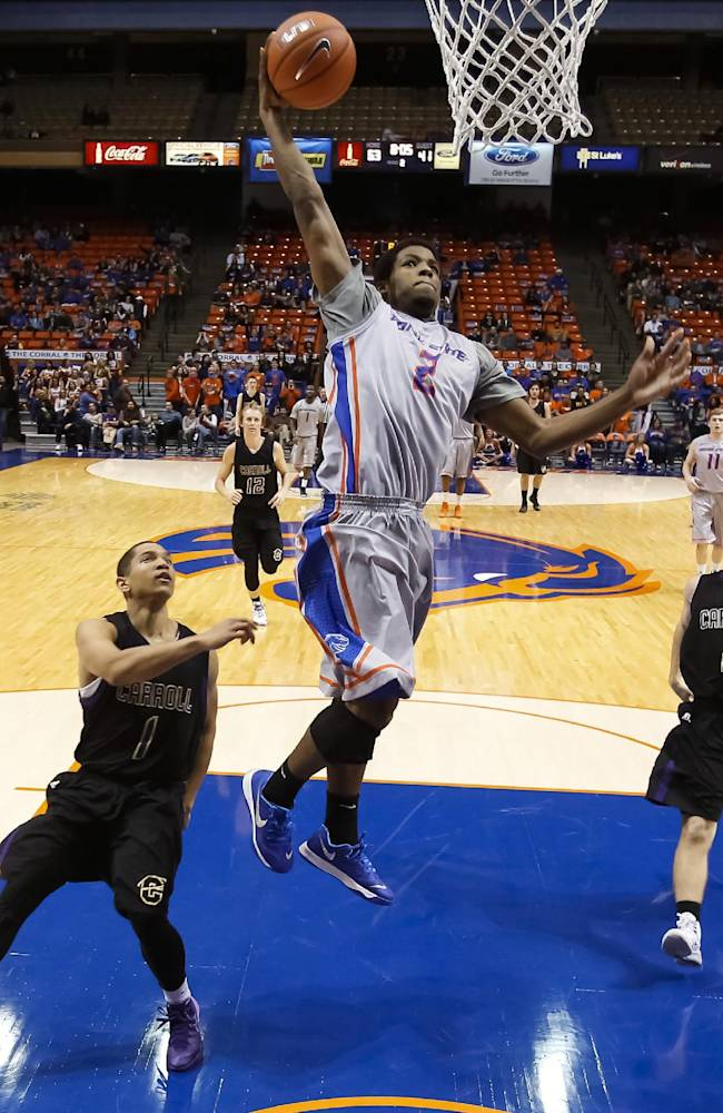 Boise State's Derrick Marks (2) goes up to the basket past Carroll of Montana's Zayn Kirkendoll (1) and Ian Lorang (2) during the second half of an NCAA college basketball game in Boise, Idaho, on Thursday, Dec. 5, 2013. Boise State won 80-52