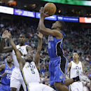 Utah Jazz's John Lucas III (5) falls as he defends against Orlando Magic's Ronnie Price (10) who goes to the basket in the second quarter during an NBA basketball game on Saturday, March 22, 2014, in Salt Lake City The Associated Press