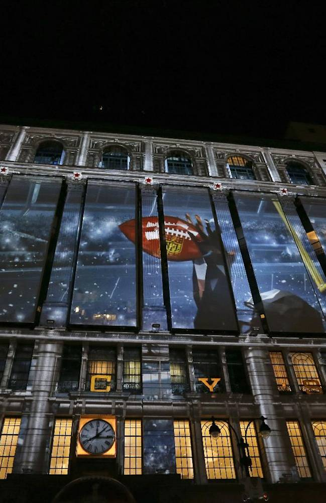 An image of a football player covers part of the Macy's department store building along Super Bowl Boulevard, Friday, Jan. 31, 2014, in New York.The Seattle Seahawks are scheduled to play the Broncos in NFL football's Super Bowl on Sunday in East Rutherford, N.J