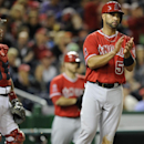 Los Angeles Angels' Albert Pujols (5) reacts after he scored on a single by Erick Aybar during the eighth inning of a baseball game as Washington Nationals catcher Jose Lobaton, left, looks on, Monday, April 21, 2014, in Washington. The Angels won 4-2 The