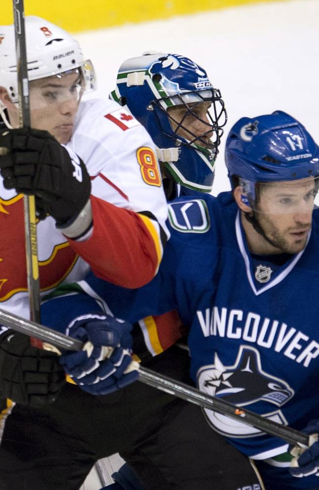 After fight-filled start, Canucks win in shootout