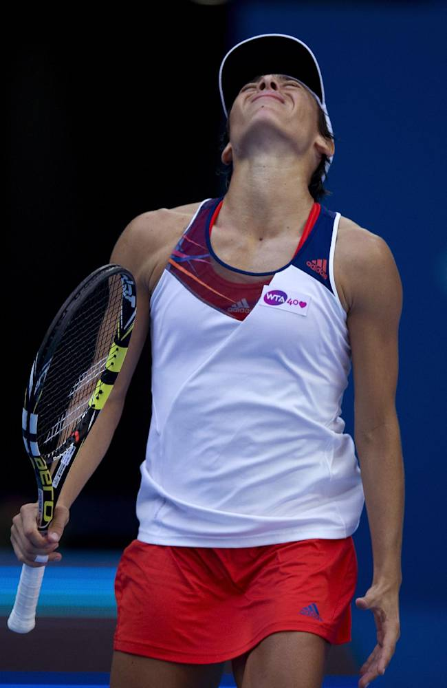 Francesca Schiavone of Italy reacts to a lost point against Serena Williams of the U.S. during the second round of the China Open tennis tournament at the National Tennis Stadium in Beijing, China Tuesday, Oct. 1, 2013