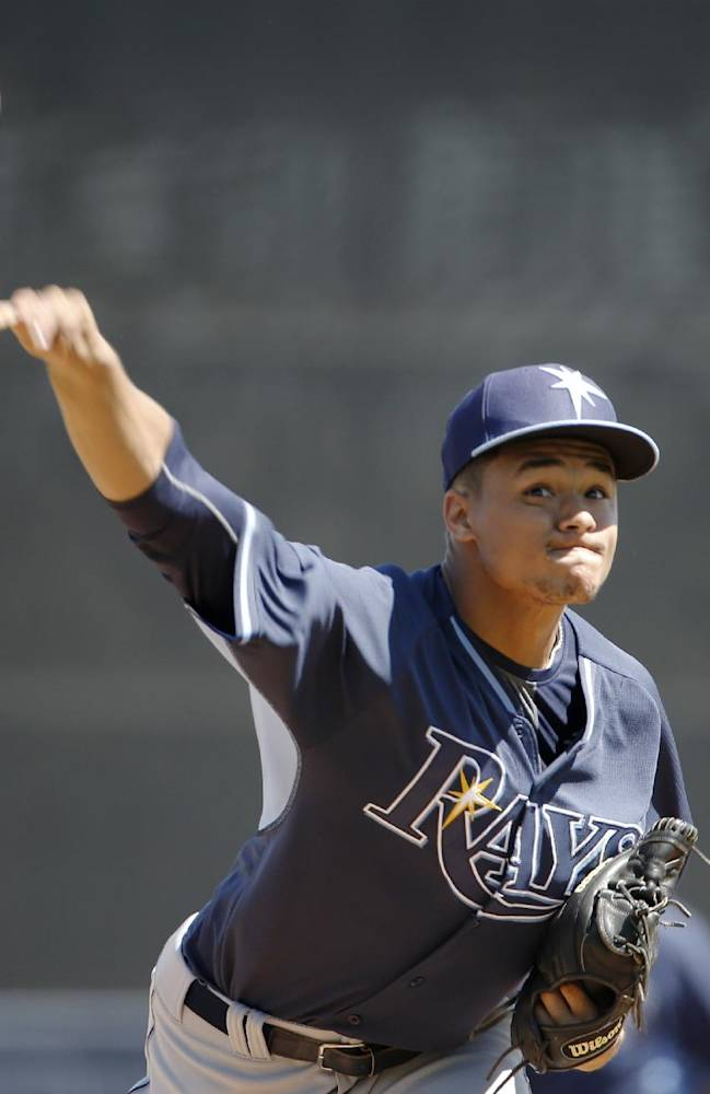 Tampa Bay Rays starter Chris Archer delivers a warmup pitch before a spring training baseball game against the New York Yankees in Tampa, Fla., Sunday, March 9, 2014