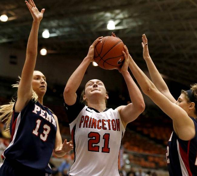 Princeton forward Alex Wheatley (21) goes up for a shot against Penn center Sydney Stipanovich (13) and forward Kara Bonenberger during the second half of an NCAA college basketball game Tuesday, March 11, 2014, in Princeton, N.J. Penn won 80-64
