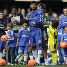 Chelsea's Paulo Ferreira talks to the crowd during a ceremony to celebrate the Europa League cup win, following their English Premier League soccer match against Everton at the Stamford Bridge ground in London, Sunday, May 19, 2013. Chelsea won the Europa League cup by beating Benfica 2-1 in Amsterdam, Netherlands on May 15, 2013. (AP Photo/Lefteris Pitarakis)