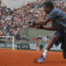 Gael Monfils of France returns against Tommy Robredo of Spain  in their third round match at the French Open tennis tournament, at Roland Garros stadium in Paris, Friday, May 31, 2013. (AP Photo/Michel Spingler)