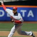 Cincinnati Reds starting pitcher Alfredo Simon throws during the first inning of the baseball game against the New York Mets at Citi Field, Sunday, April 6, 2014, in New York The Associated Press