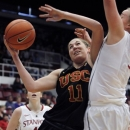 Southern California's Cassie Harberts (11) shoots as Stanford's Mikaela Ruef defends during the first half of an NCAA college basketball game, Sunday, Jan. 20, 2013, in Stanford, Calif. (AP Photo/George Nikitin)