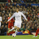Real Madrid's Cristiano Ronaldo, centre, races away from the Liverpool defence during the Champions League group B soccer match between Liverpool and Real Madrid at Anfield Stadium, Liverpool, England, Wednesday Oct. 22, 2014