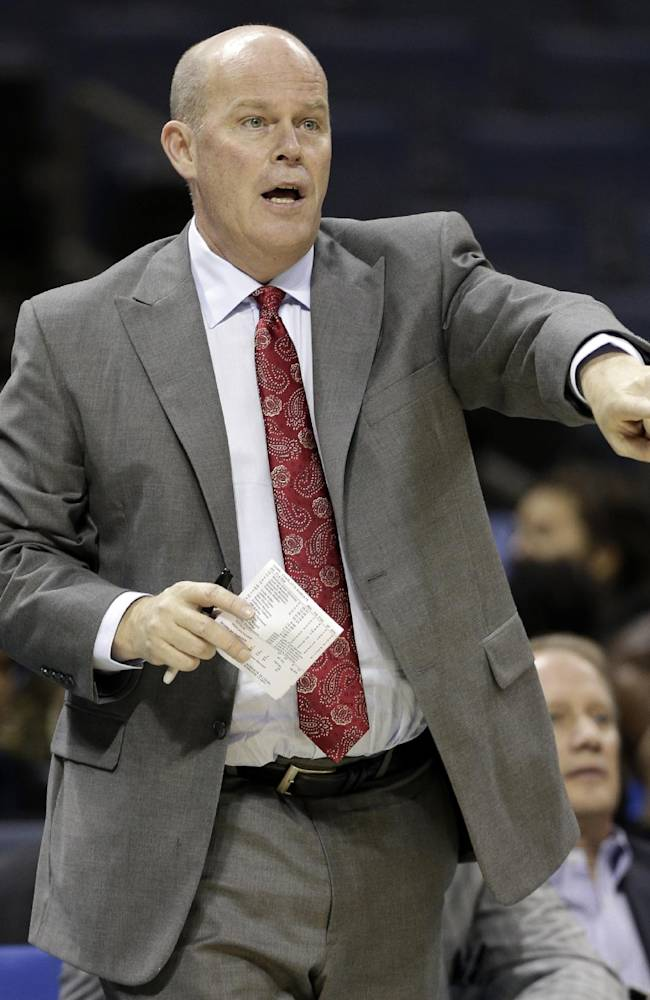 Charlotte Bobcats head coach Steve Clifford directs his team against the Philadelphia 76ers during the second half of a preseason NBA basketball game in Charlotte, N.C., Thursday, Oct. 17, 2013. The Bobcats won 110-84