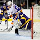 New York Islanders center Brock Nelson (29) takes a shot on Los Angeles Kings goalie Martin Jones (31) during the first period of an NHL hockey game on Saturday, Dec. 7, 2013, in Los Angeles.(AP Photo/Gus Ruelas)