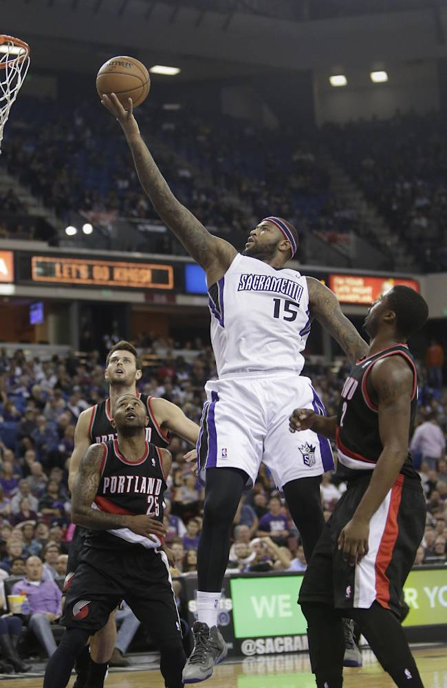 Sacramento Kings center DeMarcus Cousins,center, goes to the basket between  Portland Trail Blazers' Mo Williams, left, and Wesley Matthews, right, during the third        quarter of an NBA basketball game in Sacramento, Calif., Saturday, Nov. 9, 2013.  The Trail Blazers won 96-85