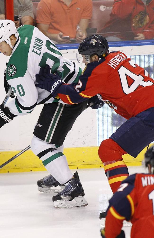 Dallas Stars center Cody Eakin (20) and Florida Panthers center Quinton Howden (42) fight for the puck during the first period of an NHL hockey game in Sunrise, Fla., Sunday, April 6, 2014
