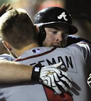 Atlanta Braves' Brian McCann celebrates his two-run homer with Freddie Freeman in the fifth inning of a baseball game against the Philadelphia Phillies on Friday, Aug. 2, 2013, in Philadelphia. (AP Photo/Michael Perez)