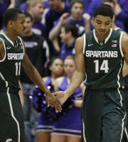 Michigan State guard Gary Harris (14) celebrates with guard Keith Appling (11) after scoring a basket during the second half of an NCAA college basketball game against Northwestern in Evanston, Ill., on Wednesday, Jan. 15, 2014. Michigan State won 54-40. (AP Photo/Nam Y. Huh)