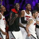 Louisville's Kevin Ware (5), Montrezl Harrell (24), Peyton Siva, right front,, Zach Price (25) and Gorgui Dieng (10) react after a basket in the second half of an NCAA college basketball game against Missouri at the Battle 4 Atlantis tournament Friday, Nov. 23, 2012 in Paradise Island, Bahamas. (AP Photo/John Bazemore)