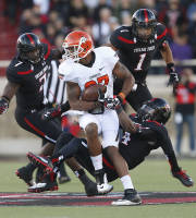 Oklahoma State's Tracy Moore (87) is swarmed by Texas Tech's Will Smith (7), Terrance Bullitt (1) and Derrick Mays (4) during their NCAA college football game in Lubbock, Texas, Saturday, Nov. 2, 2013. (AP Photo/Lubbock Avalanche-Journal,Stephen Spillman)