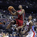 Miami Heat guard Toney Douglas, left, goes to the basket against Detroit Pistons guard Kentavious Caldwell-Pope (5) during the second half of an NBA basketball game on Friday, March 28, 2014, in Auburn Hills, Mich. The Heat defeated the Pistons 110-78 The