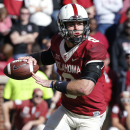Oklahoma quarterback Trevor Knight (9) is pictured during an NCAA college football game between Baylor and Oklahoma in Norman, Okla., Saturday, Nov. 8, 2014. Baylor won 48-14. (AP Photo/Sue Ogrocki)