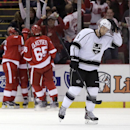 Los Angeles Kings' Jake Muzzin (6) skates away as the Detroit Red Wings celebrate a goal by Detroit Red Wings' Pavel Datsyuk during the first period of an NHL hockey games Friday, Oct. 31, 2014, in Detroit The Associated Press