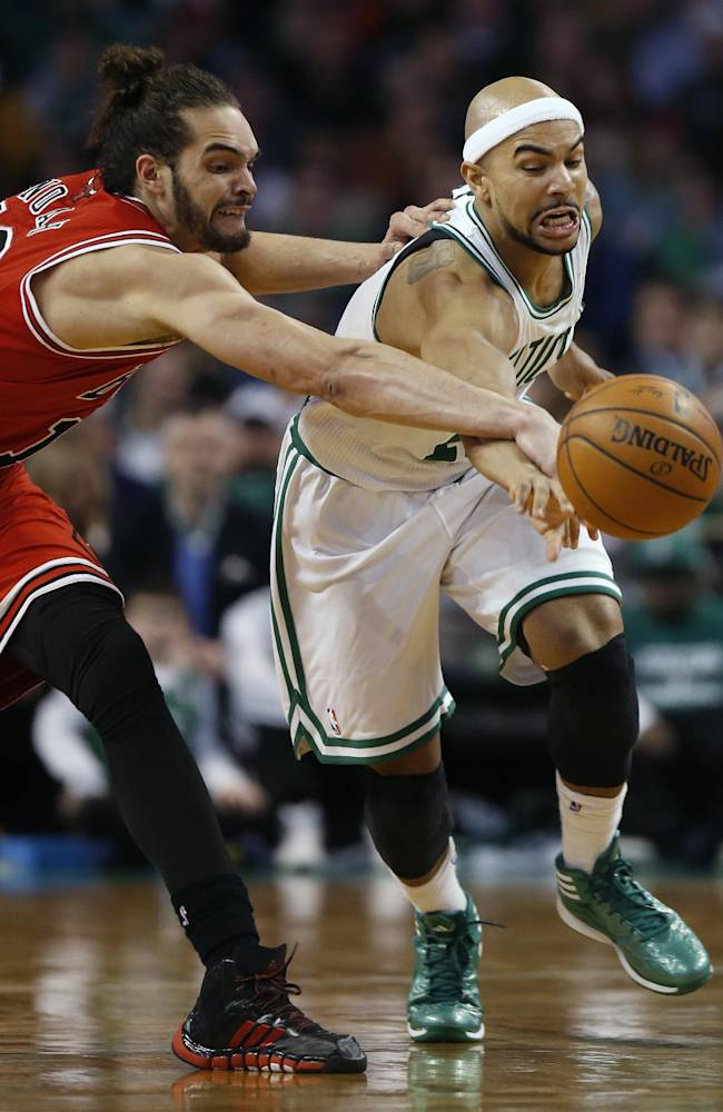 Chicago Bulls' Joakim Noah (13) and Boston Celtics' Jerryd Bayless (11) chase a loose ball in the fourth quarter of an NBA basketball game in Boston, Sunday, March 30, 2014. The Bulls won 107-102