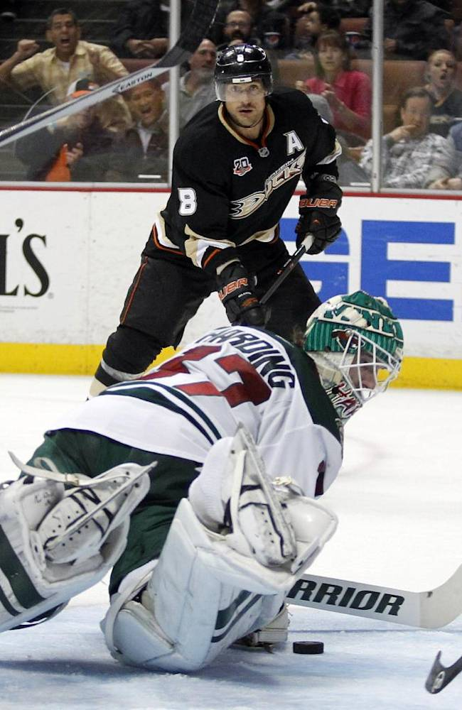 Minnesota Wild goalie Josh Harding, right, stops a shot by Anaheim Ducks right wing Teemu Selanne (8), of Finland in the second period of an NHL hockey game Wednesday, Dec. 11, 2013 in Anaheim, Calif