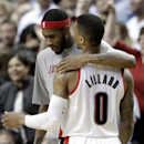 Portland Trail Blazers guard Will Barton, left, puts his arm around teammate Damian Lillard as they walk off the court during the second half of an NBA basketball game in Portland, Ore., Monday, March 3, 2014. Lillard scored 20 points and missed a three