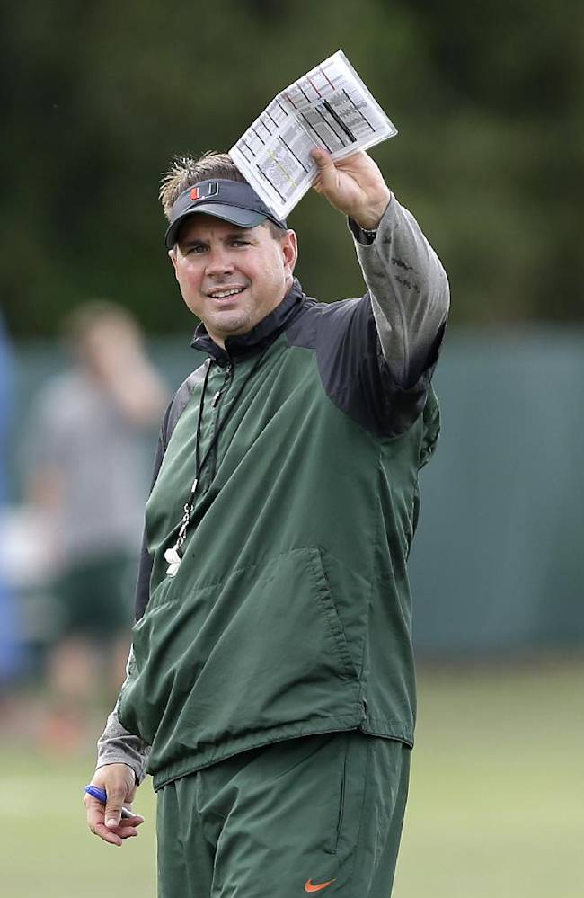 Miami head coach Al Golden gestures during team practice, Tuesday, Oct. 22, 2013, in Coral Gables, Fla. Miami's football team will lose nine scholarships and the men's basketball team will lose three, as part of the penalties the school was handed Tuesday by the NCAA as the Nevin Shapiro scandal presumably drew to a close