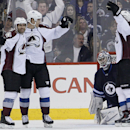 Colorado Avalanche's Maxime Talbot (25), Nick Holden (2) and Cody McLeod (55) celebrate Holden's goal against Winnipeg Jets goaltender Al Montoya during the second period of an NHL hockey game Wednesday, March 19, 2014, in Winnipeg, Manitoba The Associate