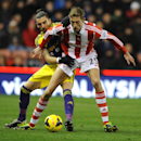 Stoke City's goal scorer Peter Crouch, right, battles for the ball with Swansea City's goal scorer Chico Flores during the English Premier League soccer match between Stoke City and Swansea City at Britannia Stadium in Stoke on Trent, England, Wednesday,