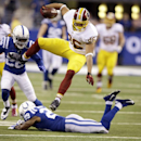 Washington Redskins tight end Jordan Reed, top, goes over Indianapolis Colts strong safety Mike Adams during the second half of an NFL football game Sunday, Nov. 30, 2014, in Indianapolis The Associated Press