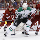Dallas Stars' Alex Chiasson (12) tries to keep the puck away from Phoenix Coyotes' Connor Murphy (5) and Jeff Halpern (14) during the second period of an NHL hockey game on Sunday, April 13, 2014, in Glendale, Ariz The Associated Press