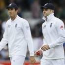 England's bowlers James Anderson, right, and Steven Finn leave the pitch after New Zealand are all out for 207 during their first test match against New Zealand at Lord's cricket ground in London, Saturday, May 18, 2013. (AP Photo/Kirsty Wigglesworth)