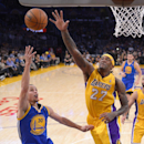 Golden State Warriors guard Stephen Curry, left, puts up a shot as Los Angeles Lakers forward Jordan Hill defends during the first half of an NBA basketball game, Friday, April 11, 2014, in Los Angeles. (AP Photo/Mark J. Terrill)