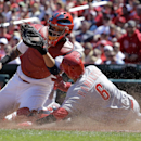 Cincinnati Reds' Billy Hamilton, right, scores ahead of the tag from St. Louis Cardinals catcher Yadier Molina on a sacrifice fly by Jay Bruce during the fifth inning of a baseball game Wednesday, April 9, 2014, in St. Louis The Associated Press