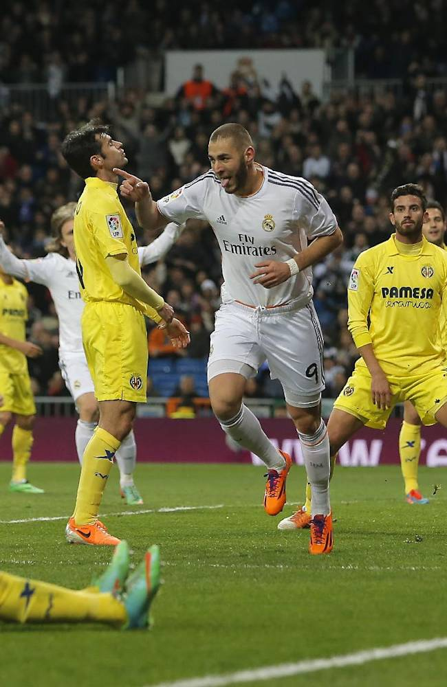 Real Madrid's Karim Benzema, centre, celebrates his goal during a Spanish La Liga soccer match between Real Madrid and Villarreal at the Bernabeu stadium stadium in Madrid, Spain, Saturday, Feb. 8, 2014