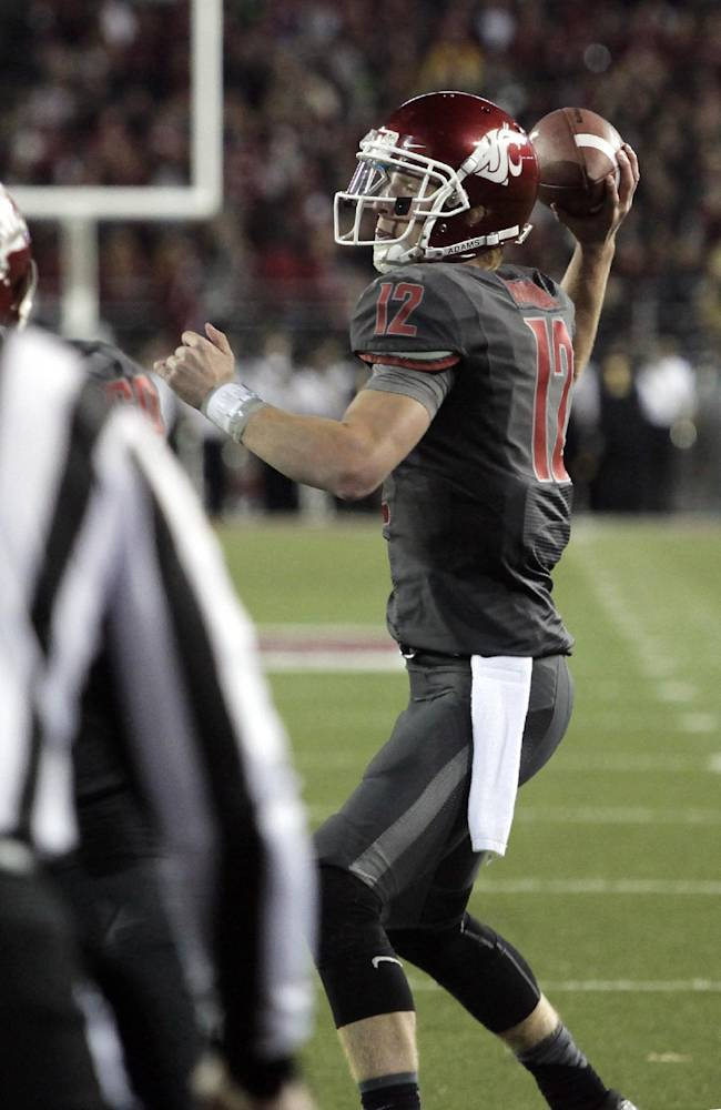 Washington State quarterback Connor Halliday (12) throws a touchdown pass to wide receiver Gabe Marks, not seen, during the first quarter of an NCAA college football game against Idaho on Saturday, Sept. 21, 2013, in Pullman, Wash