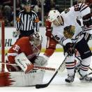 Detroit Red Wings goalie Jimmy Howard (35) stops a shot by Chicago Blackhawks center Andrew Shaw (65) during the first period in Game 4 of the Western Conference semifinals in the NHL hockey Stanley Cup playoffs in Detroit, Thursday, May 23, 2013. (AP Photo/Paul Sancya)